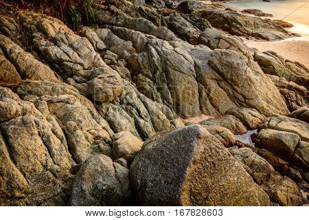 close up background and texture of break granite stone at Naiharn Beach Phuket Province Thailand.