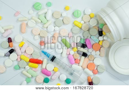 various kinds of medical treatment pills, capsules and syringes