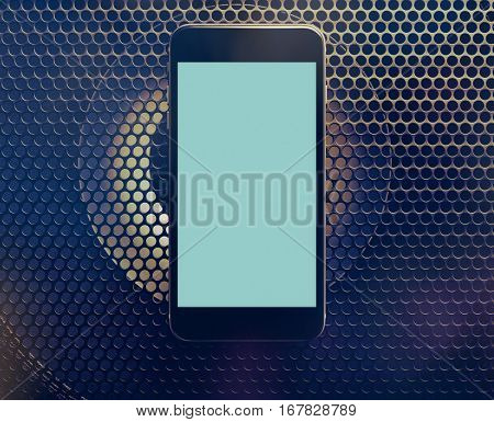 Black smartphone mockup with audio speaker background. Clipping path