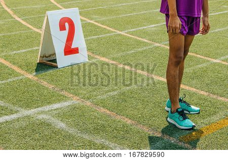 Student Boy Runner Stand On The Line At The Start Of The Track And Field. Start Of Children Running