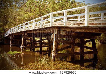 Historic wooden Varney Bridge across Kangaroo Creek at Audley, Royal National Park, Sydney, Australia. Retro toned.