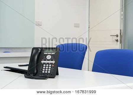 Close up IP phone in modern boardroom for meeting