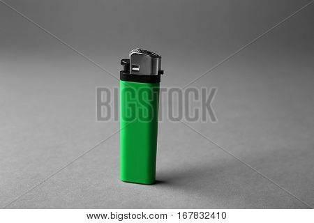 Blank green cigar lighter on grey background