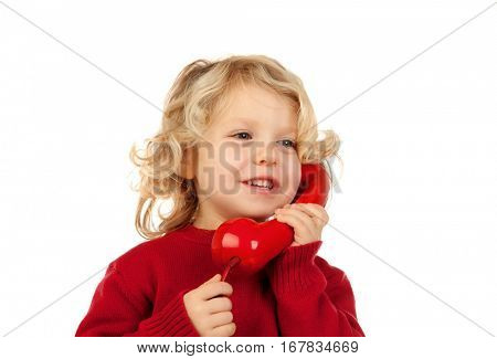 Funny little child talking on the phone isolated on a white background