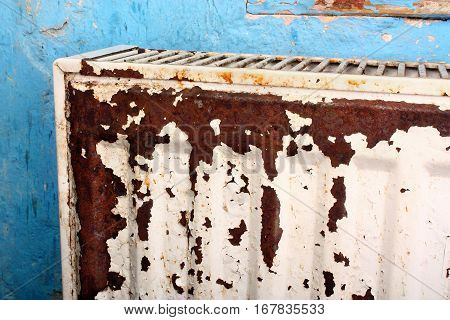 Rusty destroyed devastated moldy radiator central heating at home