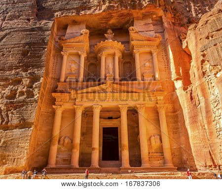 Yellow Golden Treasury Morning Siq Petra Jordan Petra Jordan. Treasury built by the Nabataens in 100 BC. Yellow Canyon becomes rose red when sun goes. Inside buildings walls create many abstracts close up. The rose red can become blood red. Reds are creat