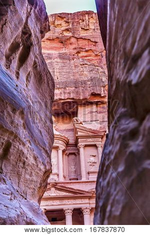 Outer Siq Rose Red Pink Treasury Afternoon Petra Jordan Petra Jordan. Treasury built by the Nabataens in 100 BC. Yellow Canyon becomes rose red when sun goes down. The rose red can become blood red. Reds are created by magnesium in sandstone.