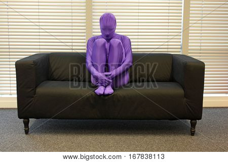 loneliness - anonymous, crooked,depressed,man sitting on sofa in office,