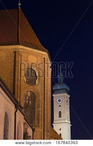 Night shot of St. Peter's Church (Peterskirche) on the left and Heiliggeistkirche on the right