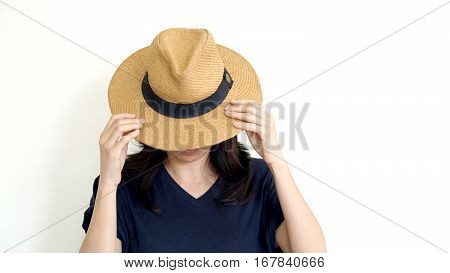 Asian Woman Hide Face Behind Hat. Introvert And Antisocial Concept