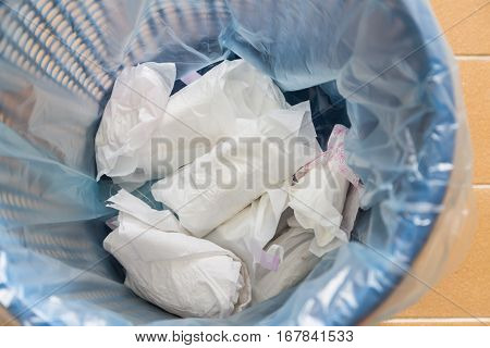 Closeup Used Sanitary Napkin Pad Wrapped Disposed In Rubbish Bin