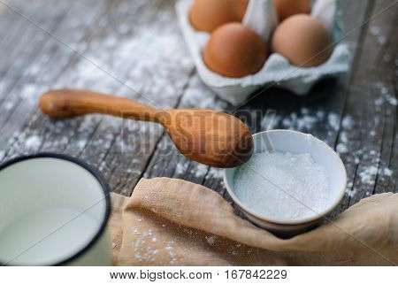 handcarved wooden spoon and cooking a sweet pie