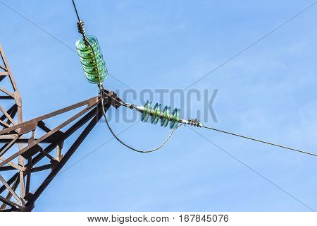 Pillar of electricity transmission line with transparent insulators. On wires and electrical components . Photographed close-up