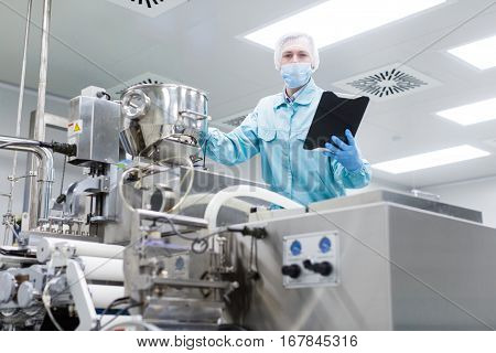 Scientist Check Readings Of Machine