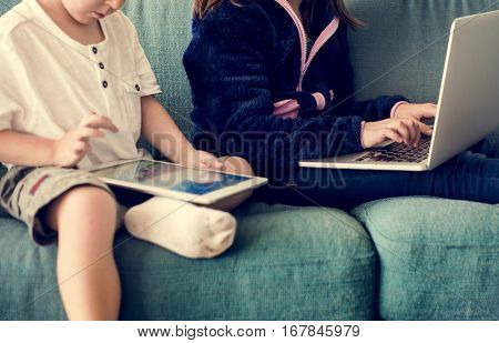 Sister Brother Playing Techie Digital Device