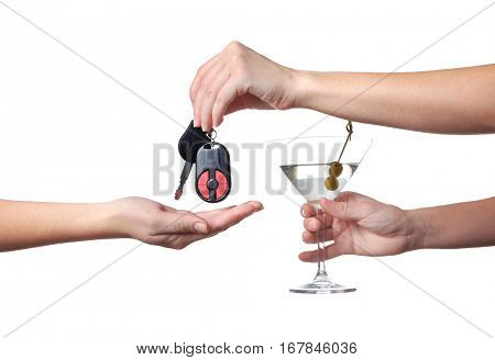 Hands of drunk woman giving car key to her friend, on white background. Don't drink and drive concept