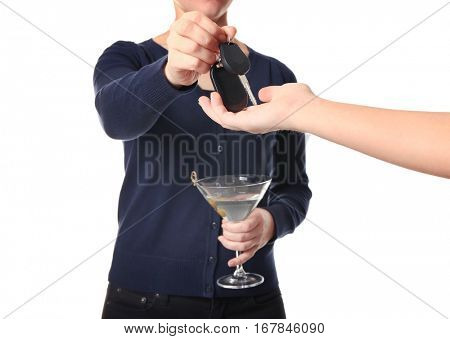 Drunk woman giving car keys to her friend, closeup. Don't drink and drive concept