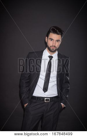 One Young Man Posing Suit, Looking At Camera, Black Background