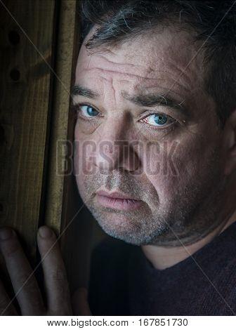Portrait of pensive sad middle-aged men.