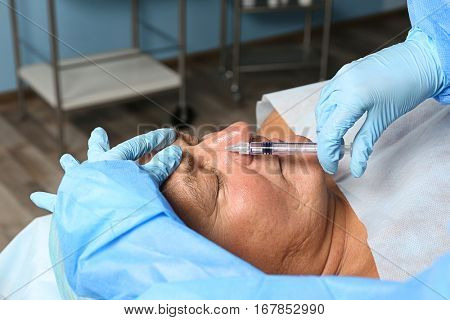 Procedure of facial rejuvenation for senior man