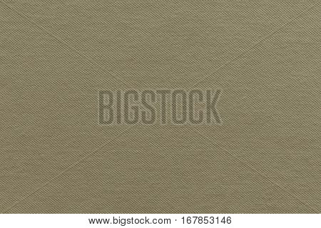 the textured background of cotton fabric or textile material of pale khaki color