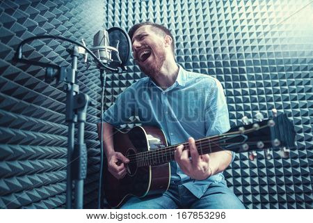 Singing man with a guitar