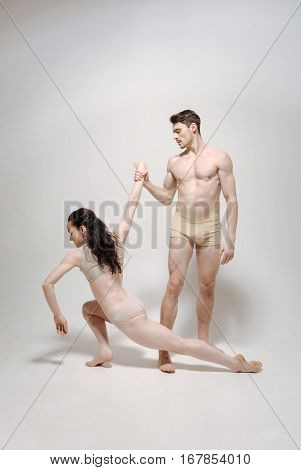 Performance of two actors. Artistic muscular pleasant actors standing in the studio and performing while expressing concentration and readiness