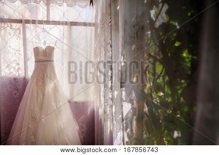 White lace off the shoulder wedding dress. Wedding dress fancy and luxury.