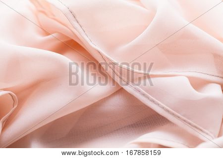 light cloth, fabric, textile with a lot of folds, plaits , creases
