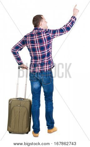 back view of  pointing man  with suitcase. brunette guy pointing .  backside view of person.  Rear view people collection. Isolated over white background. guy with a travel