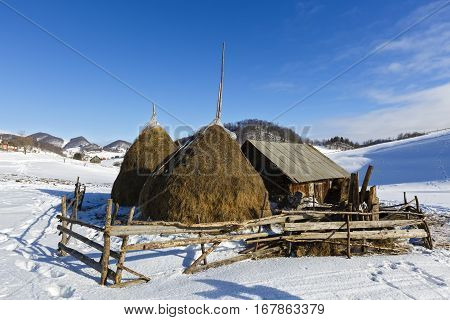 Haystacks In Winter Mountain Somewhere In Romania