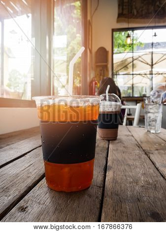 A Cup Of Ice Lemon Tea On Wooden Table