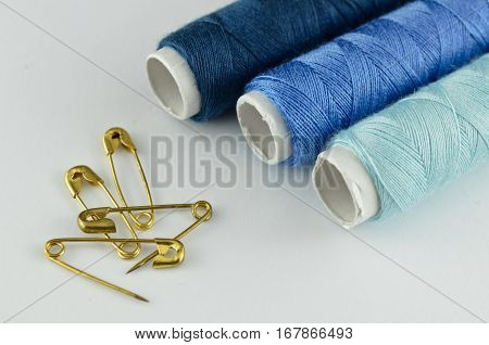 Closeup blue sewing kit isolated on white background