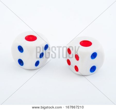 dice with blue and red dots on a white background