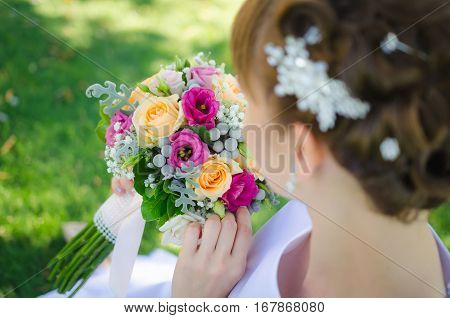 beautiful colorful wedding bouquet in bride's hand