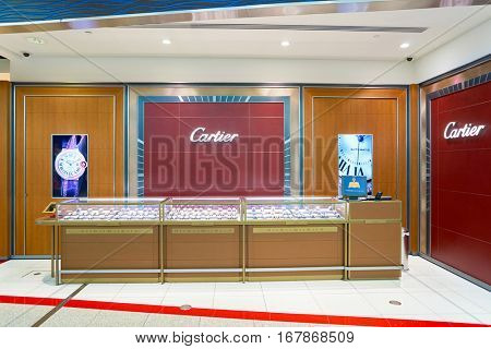 DUBAI, UAE - CIRCA NOVEMBER, 2016: Cartier store at Dubai International Airport. Cartier is a French luxury goods conglomerate company.