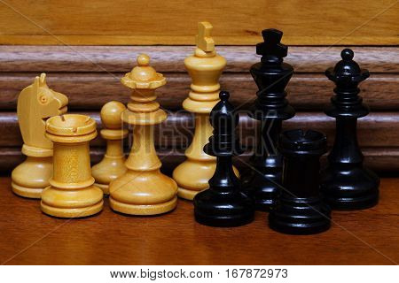 Wood Chess pieces on a wooden board