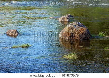 River With Stones On The Plain
