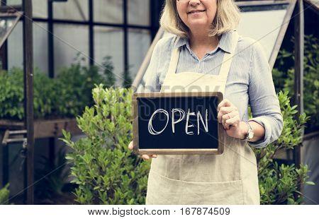 Mature Lady Open Sign Garden Shop