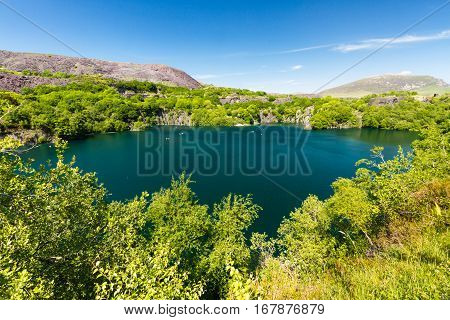 Looking across the disused Dorothea Slate Quarry Nantlle Gwynedd Wales United Kingdom. Flooded with water.