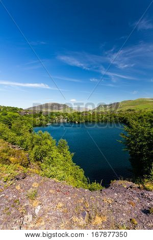 Looking across the disused Dorothea Slate Quarry to Snowdon Nantlle Gwynedd Wales United Kingdom. Flooded with water.