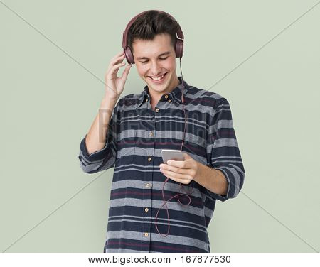 Young man casual listening to music