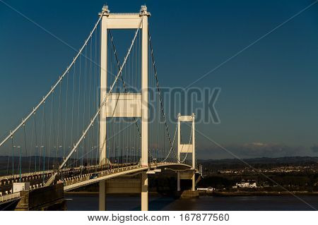 The old Severn Crossing welsh Pont Hafren bridge that crosses from England to Wales across the rivers Severn and Wye. Space to right.