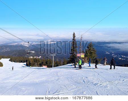 Borovets, Bulgaria - January 30, 2017: Panorama of winter mountains, skiers on ski slopes in bulgarian alpine ski resort Borovets