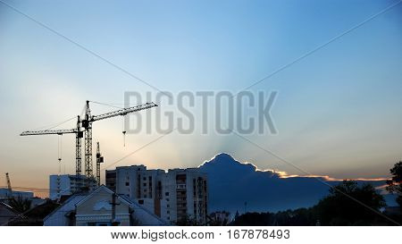 sunrise over the city, building crane in the background