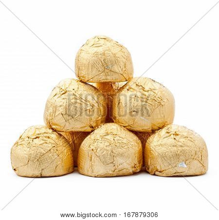 chocolates in a gold foil papper on white background