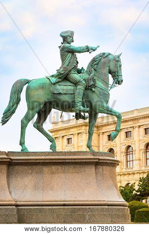 man on horse statue and nice old house in Vienna, Austria