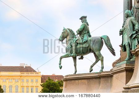 Background with man on horse statue and nice houses in Vienna, Austria