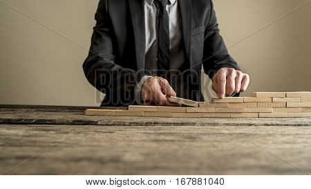 Businessman Hands Building Wall Or Staircase Concept