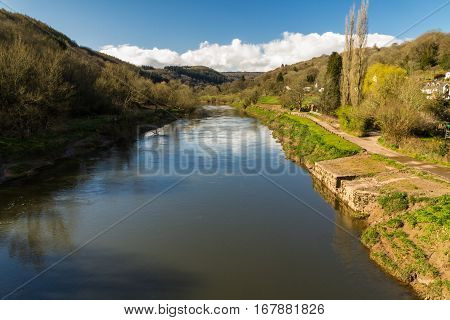 Afternoon view of the River Wye the border between England and Wales Brockweir. Old Quay on the right. poster